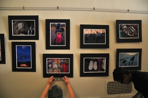 straightening the photos for the exhibition